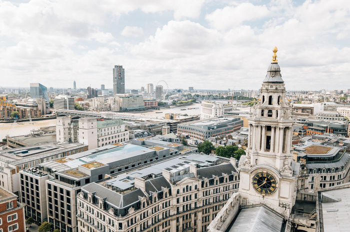 Aerial view of London from the dome of St Paul´s Church a cloudy day with a clock on the foreground Architecture Brexit Building Exterior City City Life Cityscapes Clouds And Sky Cloudy Day England European  High Angle View London London Eye London EyeEm Meetup Sky Top