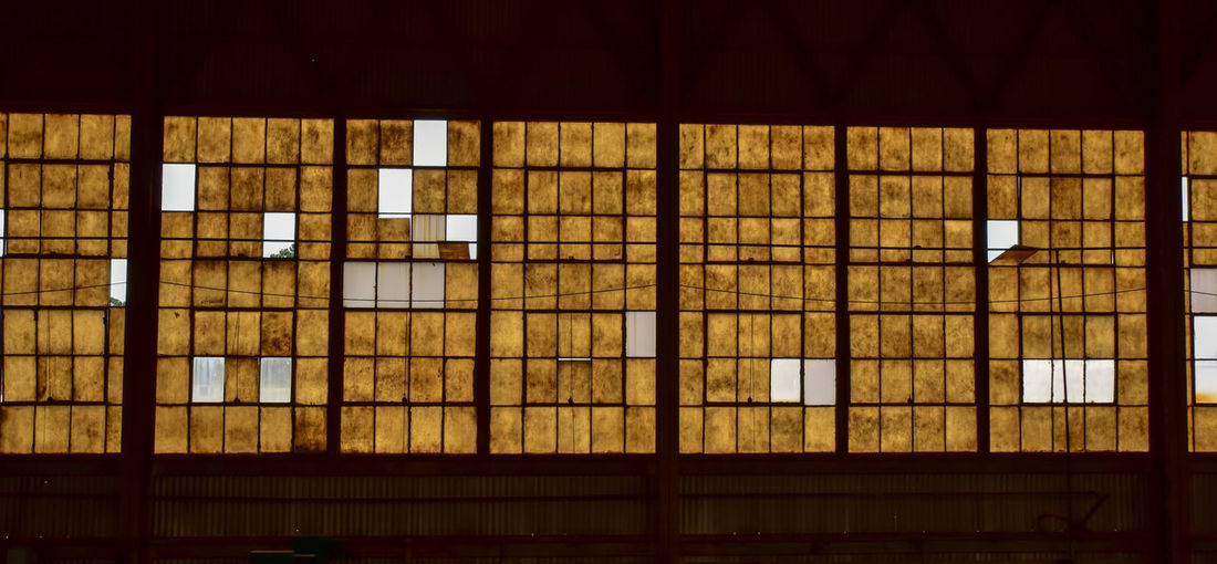 abandoned factory windows Bradley Olson Bradleywarren Photography Old Abandoned Weathered Architecture Window No People Building Illuminated Built Structure Indoors  Night Glass - Material In A Row Lighting Equipment Low Angle View Nature Backgrounds Grid City Pattern Full Frame Light Factory