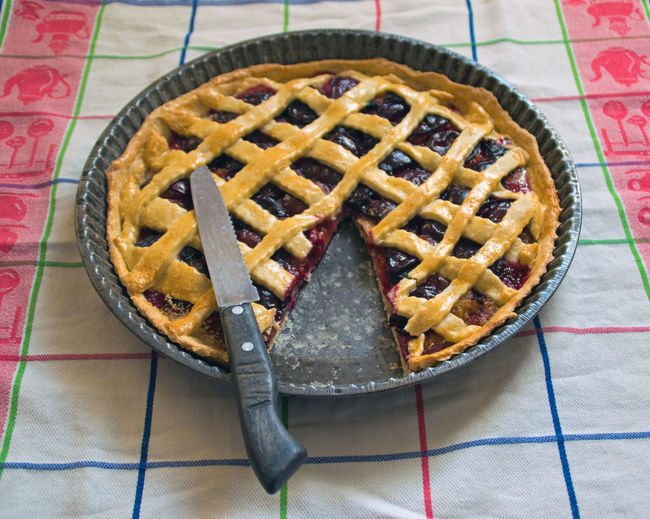View of berry pie with missing bite
