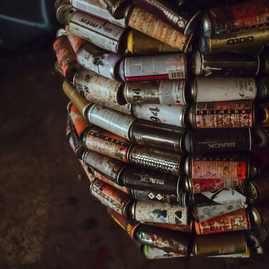 Graffiti cans Graffiti Spraying Stack Abundance Can Car Choice Close-up Communication Container Equipment Focus On Foreground High Angle View Indoors  Large Group Of Objects Metal No People Old Pipe - Tube Stack Stationary Still Life Table First Eyeem Photo