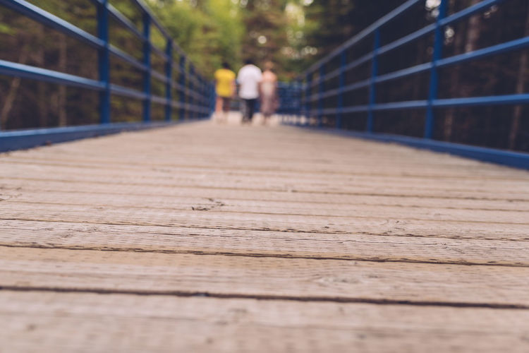 Down Low Adult Bridge Bridge - Man Made Structure Day Footbridge Low Angle Of View Nature Outdoors People Railing Real People The Way Forward