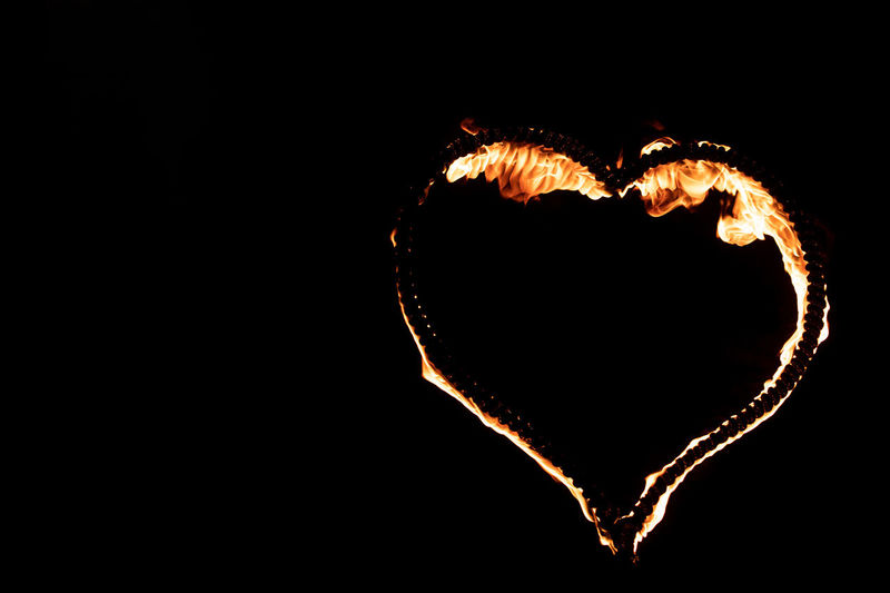 Close-up of heart shape over black background
