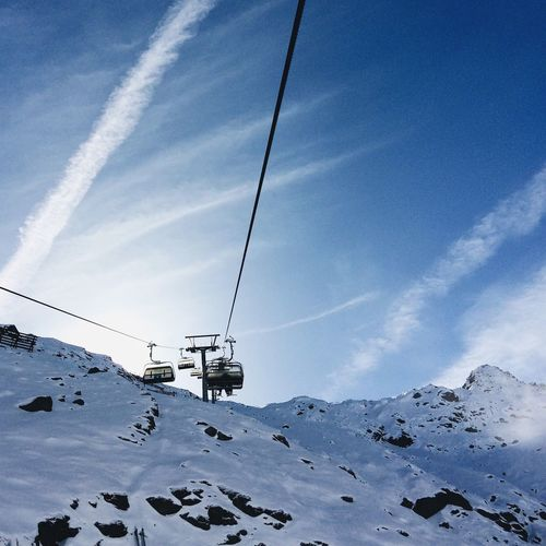Low angle view of cable cars against sky