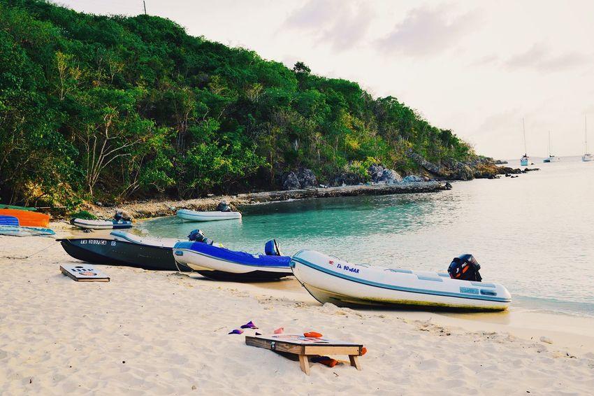 Easy life. Beach Sea Nature Boat Beauty In Nature Sand Outdoors Day Tree Sky Nikongirl Nikonistas Nikonphotography Nikon Dailycommute Lifeonanisland Caribbean Beachbar