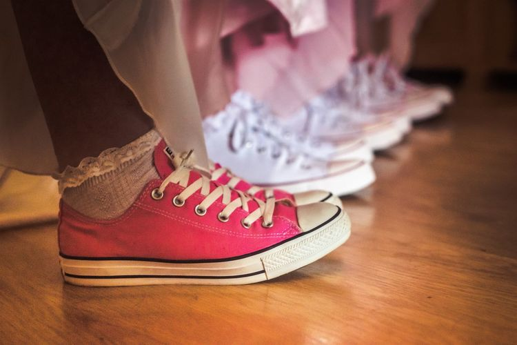 Bride and her bridesmaids wedding shoes Converse Wedding Wedding Photography Wedding Shoes Close-up Converse Wedding Day Fashion Human Leg Indoors  Low Section Men One Person Real People Shoe Shoelace Table Wedding Converse