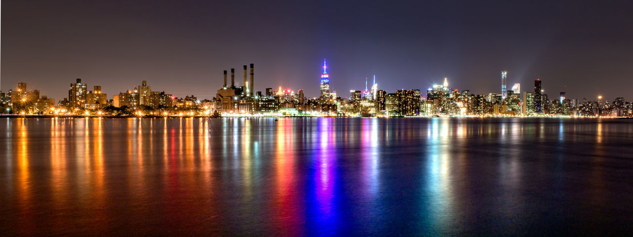 New York USA America City Architecture Built Structure Manhattan Building Exterior Building Sky Office Building Exterior Skyscraper Nature Modern No People Landscape Night Illuminated Water Reflection Waterfront Urban Skyline Cityscape Outdoors Travel Destinations City Life Purple Financial District  Travel Panorama Vibrant Color