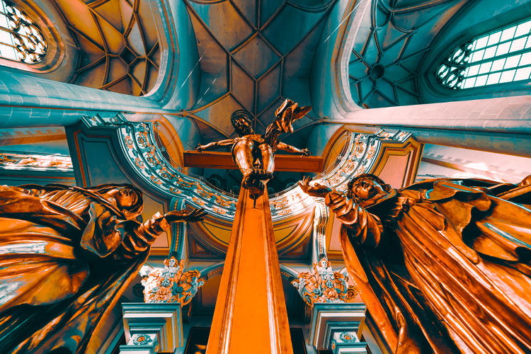 "Ingolstadt, GERMANY - January 31, 2019: The interior of the famous church ""Muenster zur schönen lieben Frau"" impresses with rich christian ornaments and paintings Architecture Built Structure Spirituality Place Of Worship Religion Belief Representation No People Day Art And Craft Indoors  Low Angle View Human Representation Building Sculpture Statue Creativity Ceiling Ornate Angel Directly Below"