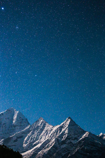 Majestic mountains against starry sky