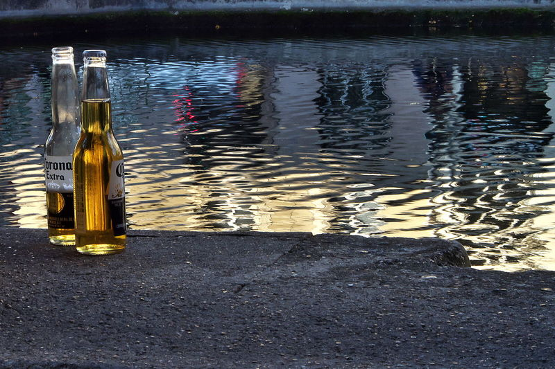 Reflection of bottle on water in lake