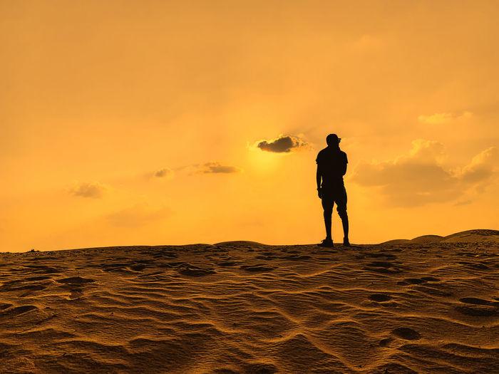 Figure staring at the desert, dubai