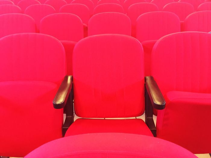 Empty red seats in theater