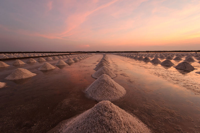 Salts At Beach Against Sky At Sunset