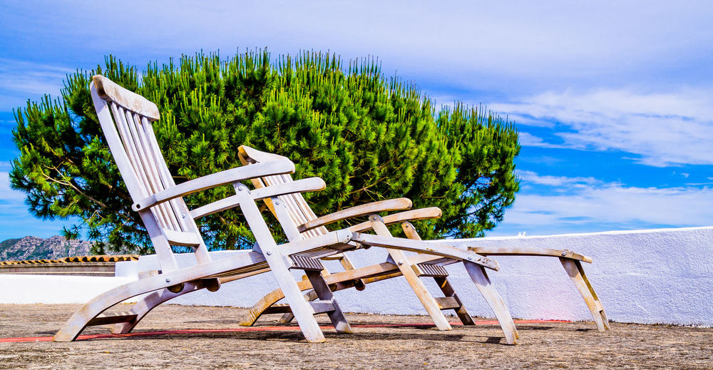 Empty wooden chairs outdoors