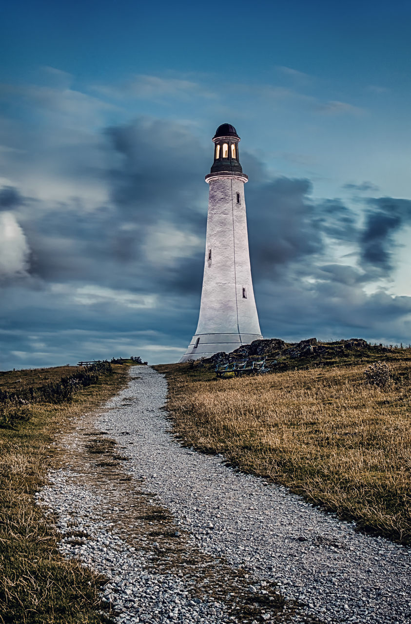 sky, cloud - sky, lighthouse, guidance, day, nature, outdoors, no people, beauty in nature, landscape, water, scenics, grass, architecture