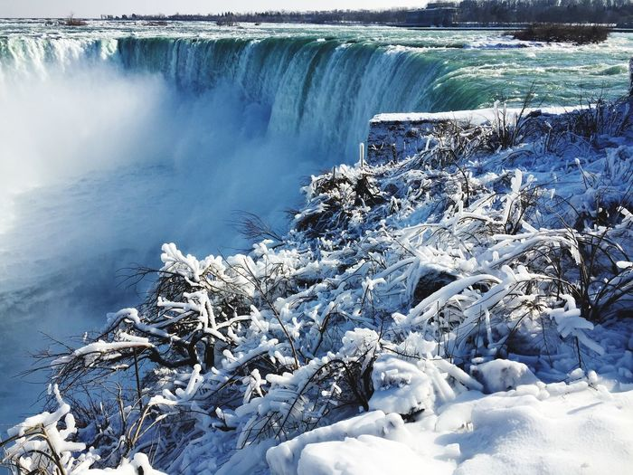 Frozen Niagara Falls on a beautiful winter day Snow Ice Popular Landmark Destination Tourism Travel River Water Frozen Nature HorshoeFalls Waterfall Canada Frosty Nature Niagara Falls Nature Water Beauty In Nature Day No People Outdoors Scenics Cold Temperature Winter Lake Motion First Eyeem Photo Shades Of Winter