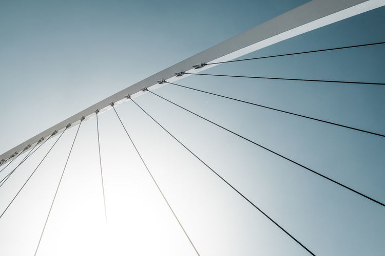 Low Angle View Of Suspension Bridge Against Clear Sky