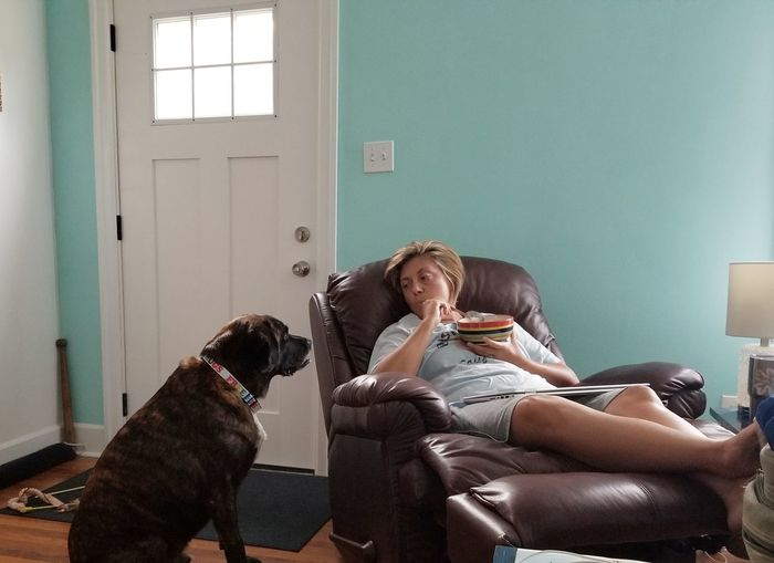 Woman with dog relaxing at home