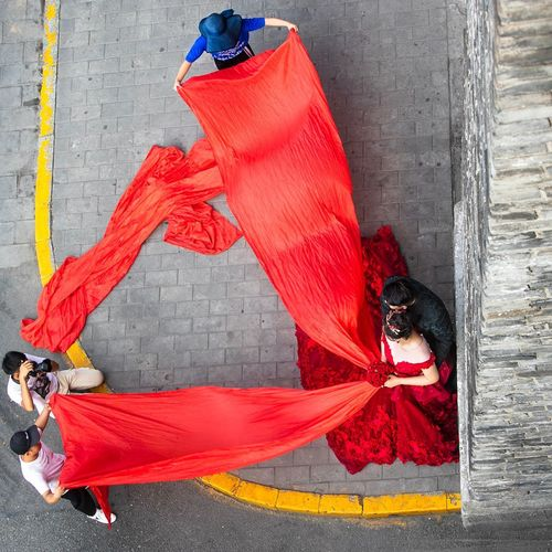 A wedding photographer at work Xi'an City Wall China Wedding Photography Street Outdoors High Angle View