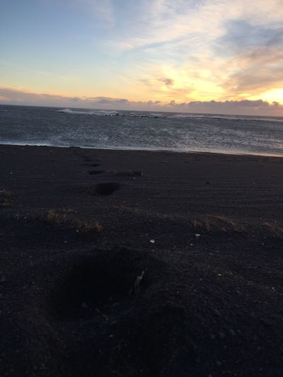 Foot Prints at the Black Beach in Iceland | 2016 Foot Footpath Sunset Back Beach Iceland Beach Travel Destinations Beauty In Nature Horizon Over Water Nature No People Tranquil Scene Water Sky Seascape Scenics Outdoors Iceland Memories