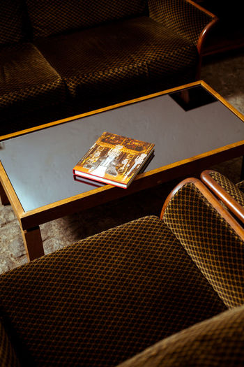 High angle view of book on table in building