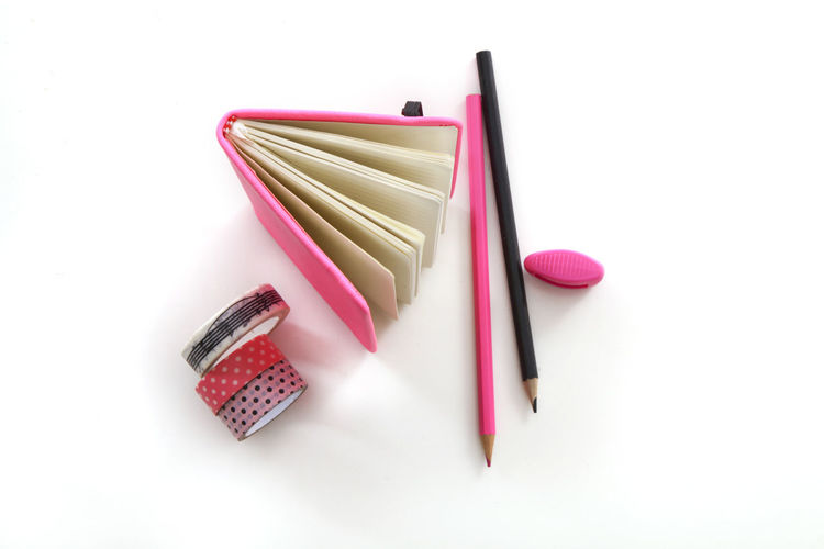 High angle view of pink pencils against white background