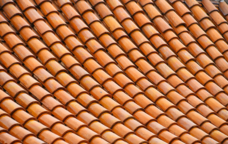 Orange ceramic roof tiles Architectural Detail Architecture Asian  Brown Ceramic Decor Decoration Decorative Details Religious Architecture Roof Roof Tile Roofs Rooftop Rooftops Spotted In Thailand Thai Thailand Tiles Yellow Color Palette