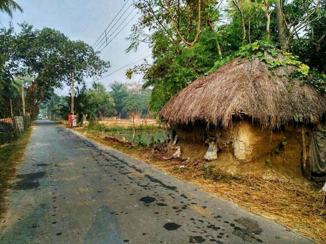 Country road take me home Beauty In Nature Day EyeEm Best Edits EyeEm Best Shots EyeEm Nature Lover Gallery House Hut India Indian Village Love Nature One Person Outdoors People Plant Real People Road Roadtrip Sky Thatched Roof Tree Village Village Life Vintage EyeEmNewHere The Great Outdoors - 2017 EyeEm Awards The Street Photographer - 2017 EyeEm Awards