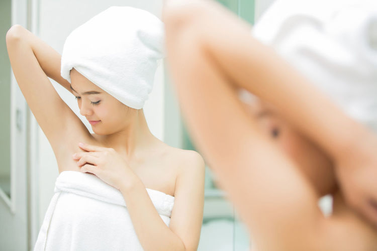 Adult Beautiful Woman Beauty Body Care Focus On Foreground Headshot Indoors  Lifestyles Mirror One Person Portrait Preparation  Relaxation Teenager Towel White Color Women Wrapped In A Towel Young Adult Young Women
