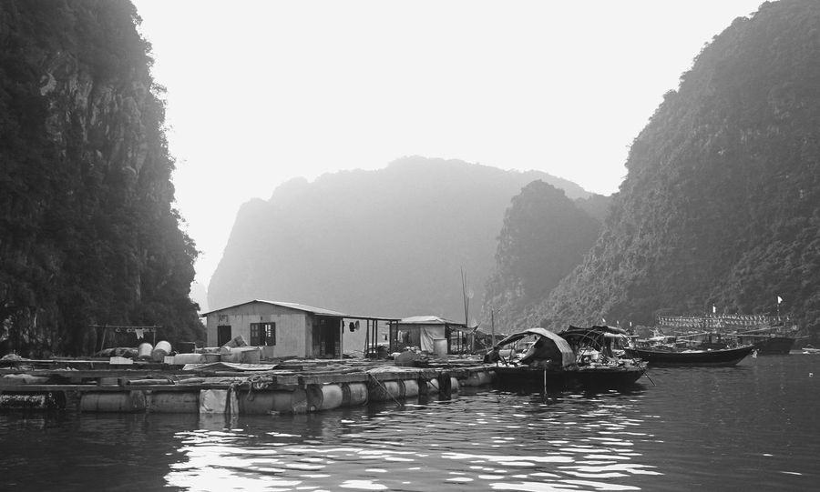 Floating village in Ha Long Bay, Vietnam Boat Boats Boats And Water Boats⛵️ EyeEm Best Shots Floating Floating On Water Ha Long Bay Moored Mountain Mountains Nautical Vessel Sea Seaside Seaside_collection This Week On Eyeem Monochrome Photography Tranquility Viet Nam Vietnam Vietnamese Village Village Life Water Waterfront