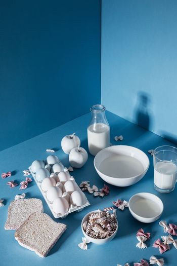 Food on table against blue wall