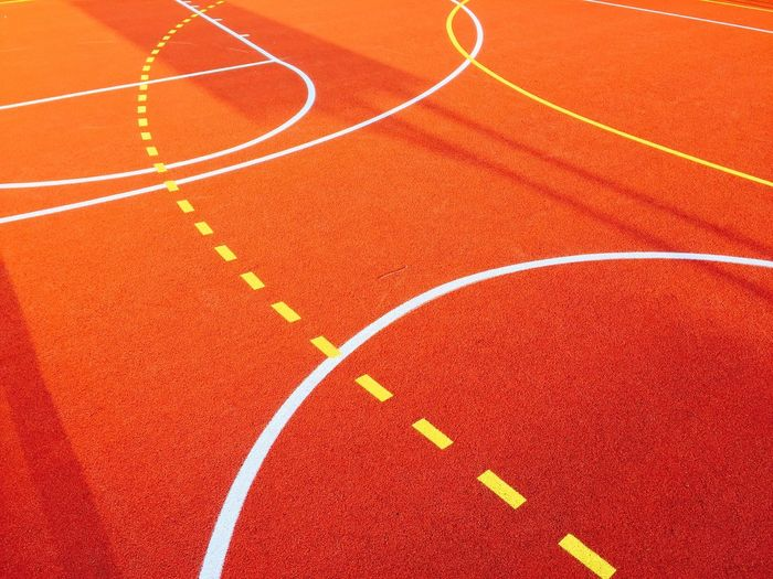 Basketball Red Running Track Sport Number Track And Field Close-up Competition Sports Track Man Made Object Competitive Sport Orange Color Single Line Creativity Dividing Line Curve Vibrant Color Playing Field Art Is Everywhere