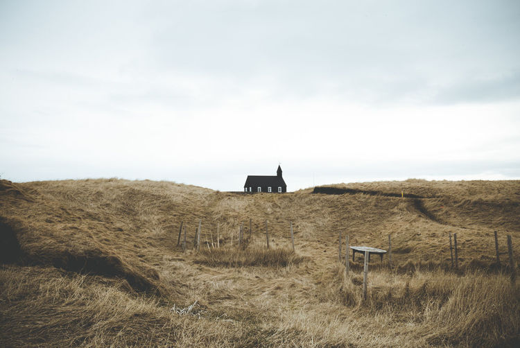 Days of travel: 4 - Western Region, Snæfellsnes Peninsula Iceland Snaefellsnes Peninsula Agriculture Architecture Black Building Building Exterior Built Structure Cloud - Sky Countryside Day Environment Field Grass Land Landscape Nature No People Non-urban Scene Outdoors Plant Rural Scene Sky Tranquil Scene Tranquility The Great Outdoors - 2018 EyeEm Awards My Best Travel Photo
