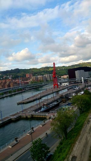 Built Structure Bridge - Man Made Structure Arts Culture And Entertainment Amusement Park Outdoors Sky Travel Destinations City Water River Architecture Cityscape Nature Bilbao Urban Skyline Lifestyles