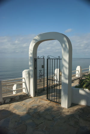 A Summer memories Beach Chance Encounters Day Embankment Fence Gate No People Outdoors Pavement Patterns Sea Shapes , Lines , Forms & Composition