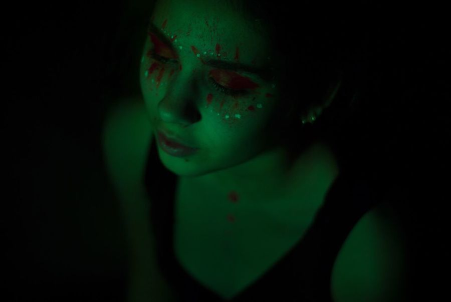 One Woman Only Only Women Dark One Person Face Paint Beautiful Woman Young Women Darkroom People Light Beauty Studio Shot Real People Green Color Light And Shadow Illuminated Green