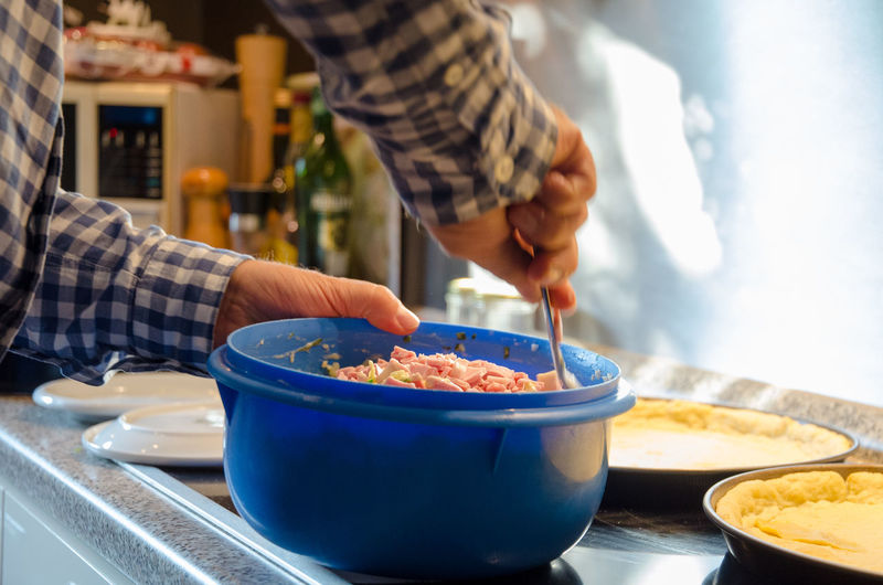 Bowl Focus On Foreground Food Food And Drink Freshness Hand Holding Human Body Part Human Hand Indoors  Kitchen Utensil Lifestyles Men Midsection One Person Preparation  Preparing Food Real People Table
