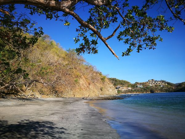 Sand Beach Reflection Water Sunshine ☀ Guanacaste, Costa Rica Dantita's Beach Day Nature Beach Beauty In Nature Scenics Horizon Over Water Sky Sea Clear Sky Tranquility Sand