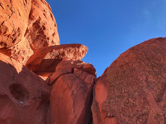 Large orange sandstone boulders in Valley of Fire State Park No Filters Or Effects Rock - Object Rock Formation Geology Nature No People Low Angle View Physical Geography Arid Climate Desert Sky Sunlight Beauty In Nature Clear Sky Travel Destinations Tranquility Outdoors Scenics Day