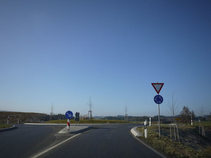Trafficsign in south Germany Allgäu Guiding Traffic Blue Clear Sky Day Full Length Guidance Guide Nature One Person Outdoors People Real People Road Road Sign Sky Speed Limit Sign Street The Way Forward Traffic Sign Transportation