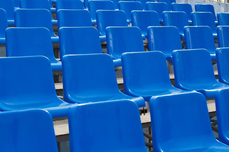 Empty stadium seats In A Row Auditorium Game Sport Event Basketball Game Football Stadium Match - Sport No People Symmetrical Monochromatic Monochrome Chair Seat In A Row Empty Absence Blue Side By Side Stadium Order Sport