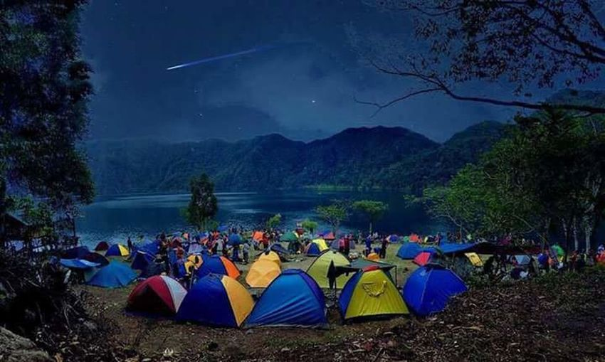 TakeoverContrast Tree Large Group Of People Tranquility Lake Water Togetherness Mountain Relaxation Scenics Night Tranquil Scene Illuminated Non-urban Scene Nature Sky Mountain Range Person Multi Colored Remote Outdoors MarjunTV TheWanderingBanana First Eyeem Photo
