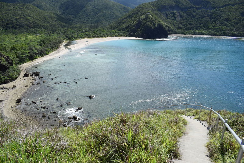 The perfect Dicasalarin cove in Baler, Philippines. Philippines BalerAuroraPhilippines Cove Cove Water Tree High Angle View Forest Grass Green Color Calm Ocean Sandy Beach Tranquility Remote Tranquil Scene Shore Horizon Over Water Mid Distance