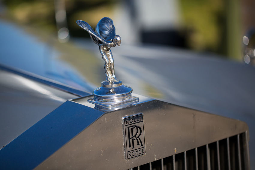 Rolls Royce Text Communication Focus On Foreground Close-up Metal Day Western Script No People Land Vehicle Transportation Mode Of Transportation Sign Outdoors Architecture Car Blue Information Selective Focus Nature Built Structure Silver Colored