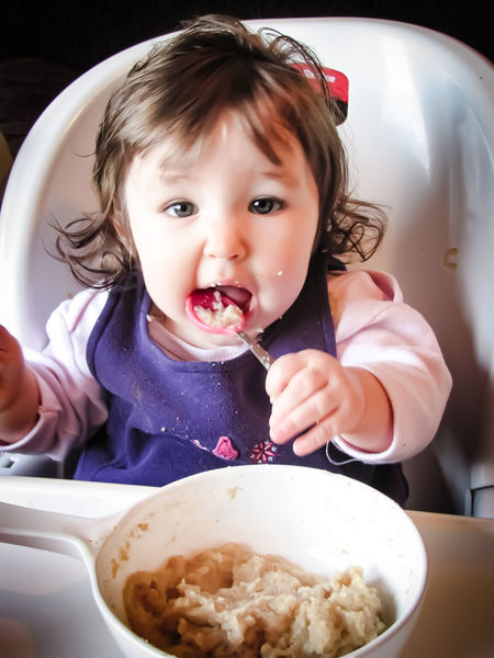 Num Num Eating High Contrast Portrait Eat Food Focus On Foreground Food And Drink Baby Lunch Childhood Girl Kids Oatmeal Cereal Breakfast Beautiful Cute Baby Babies Only Domestic Room Toddler  Childhood Domestic Kitchen Indoors  Portrait Food Child Plate Headshot One Person Domestic Life Food Stories