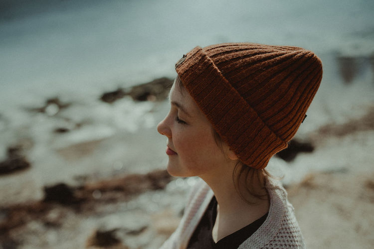 Close-Up Of Woman In Knit Hat At Beach