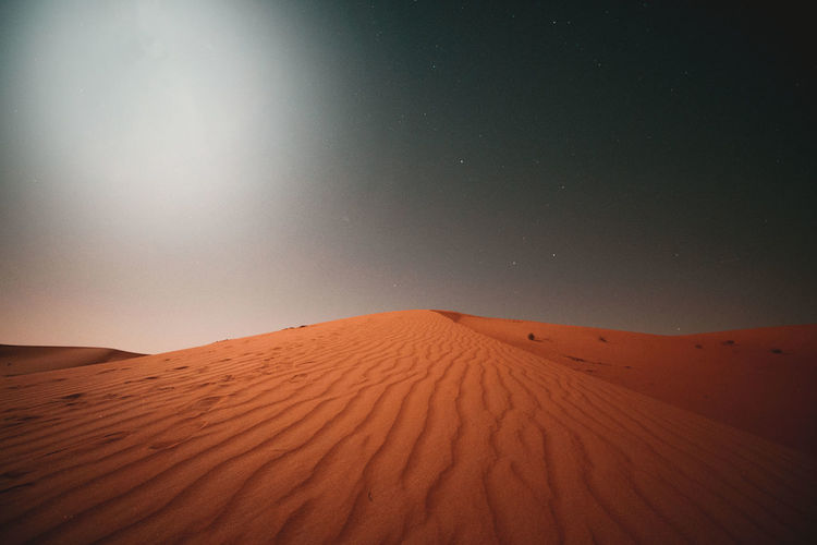 Scenic view of desert against night sky