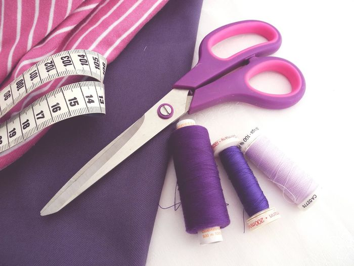 High angle view of sewing equipments with textile