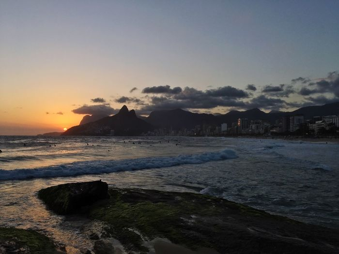 Rio de Janeiro Sunset Rio De Janeiro Eyeem Fotos Collection⛵ Rio De Janeiro Sunset Sky Water Sunset Sea Nature Beauty In Nature Scenics - Nature Beach No People Tranquility Cloud - Sky Land Tranquil Scene Architecture Mountain Building Exterior Outdoors