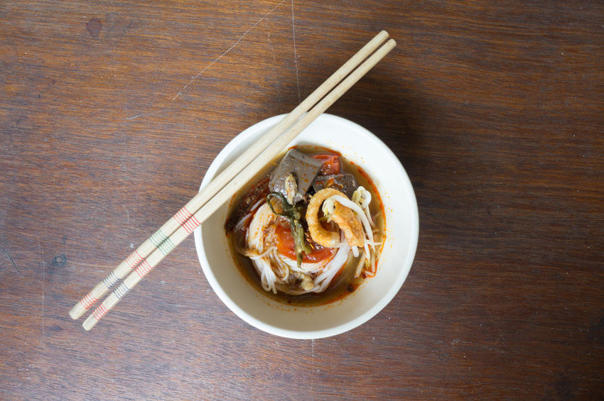 Traditional Northern Thailand Food White Noodles Spicy Soup in a Bowl, Khao Soi Nam Ngeaw, Chiangmai, Chiagrai Bowl Chopsticks Close-up Day Food Food And Drink Freshness Healthy Eating Indoors  Nam Ngeaw No People Noodles Plate Ready-to-eat Table Wood - Material