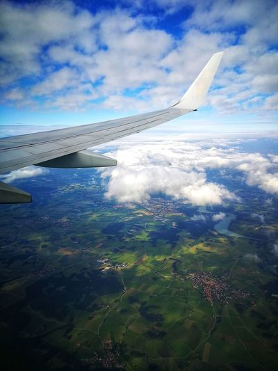 Over Bavaria Bavaria Winglet Wing Bayern Travel Flying Jetting Sky Fields Wingview Flaps Aviation Boeing Boeing 737 Airplane Flying Water Sea Aerial View Air Vehicle Commercial Airplane Blue Sky Cloud - Sky Airplane Wing Plane Cumulonimbus Fly Cumulus Cloud Aircraft Wing The Traveler - 2018 EyeEm Awards